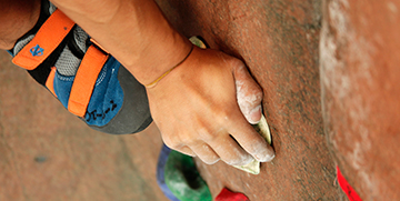 Climber's hand on the rock wall