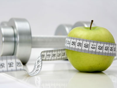 Beach Body Nutritional Counseling photo of apple with tape measure